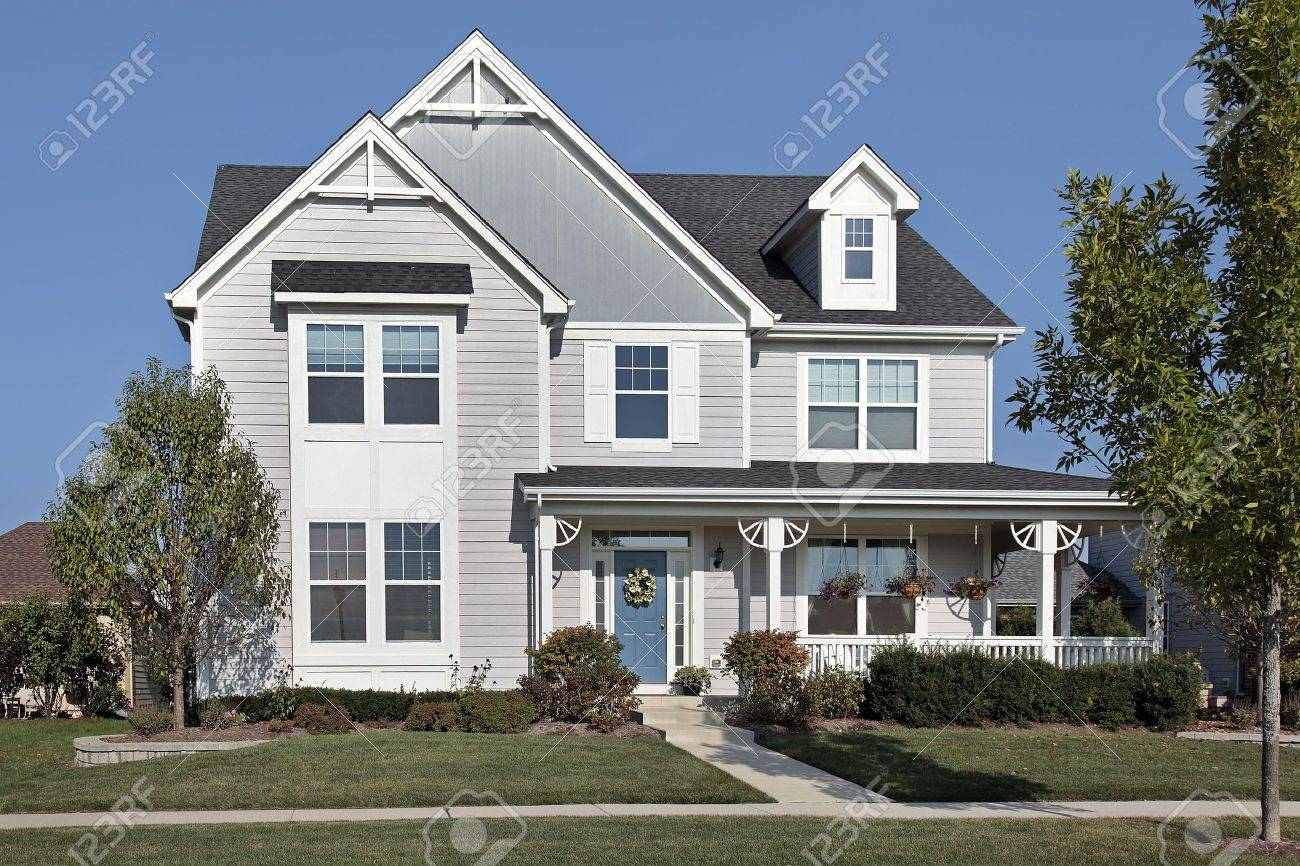 Suburban home with front porch and blue door Stock Photo - 6739316