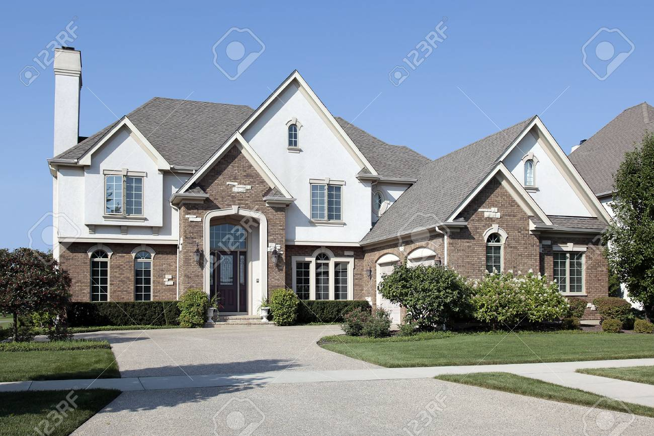Brick home in suburbs with arched entry Stock Photo - 6739113