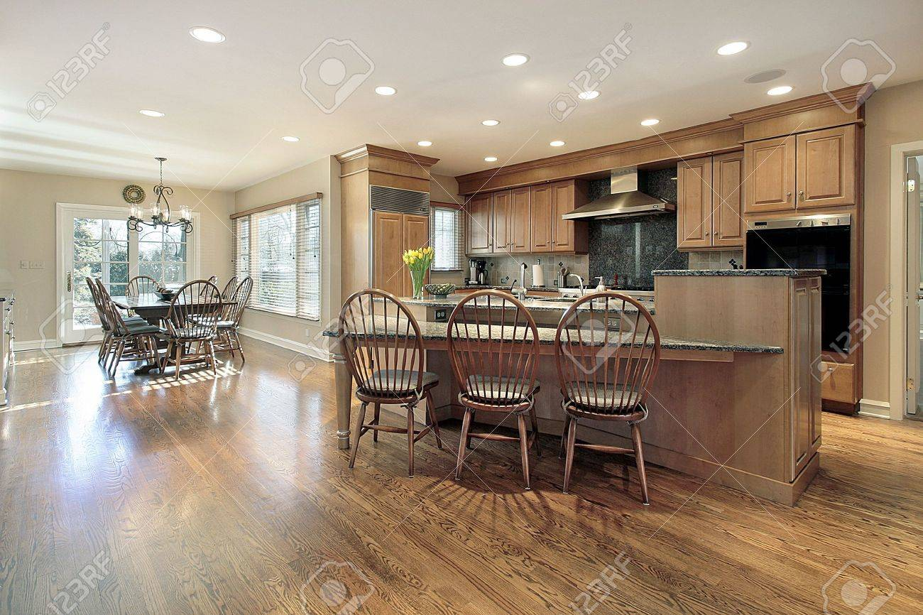 Kitchen and eating area with island in luxury home Stock Photo - 6738752