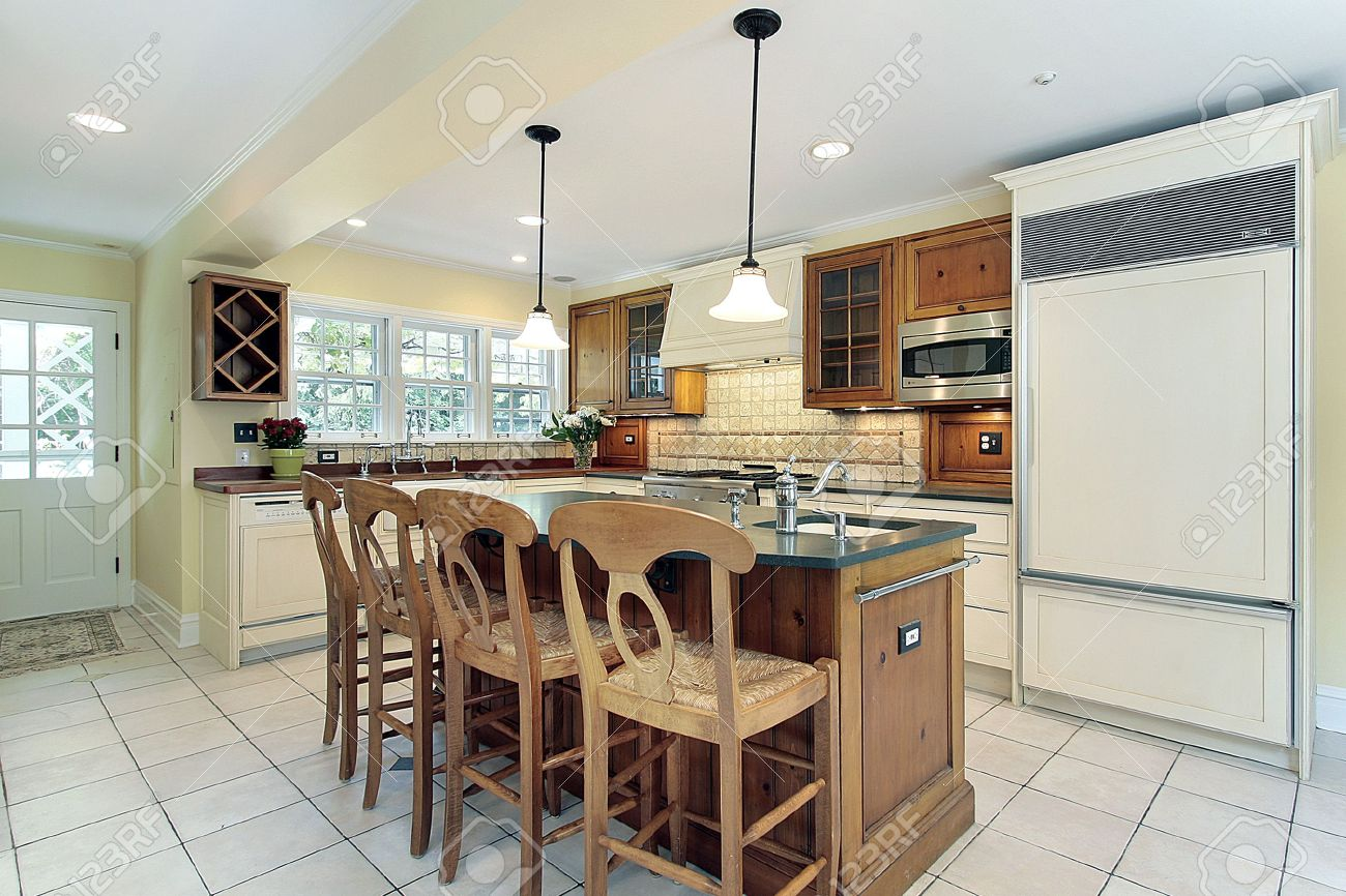 White Tile Floor Kitchen Kitchen In Suburban Home With White Tile Flooring Stock Photo