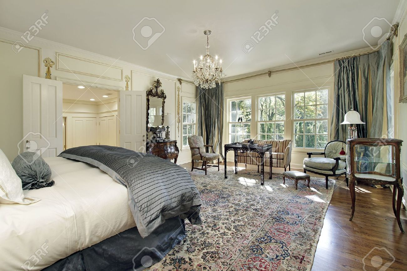 Master Bedroom In Luxury Home With Sitting Room Stock Photo   6739178