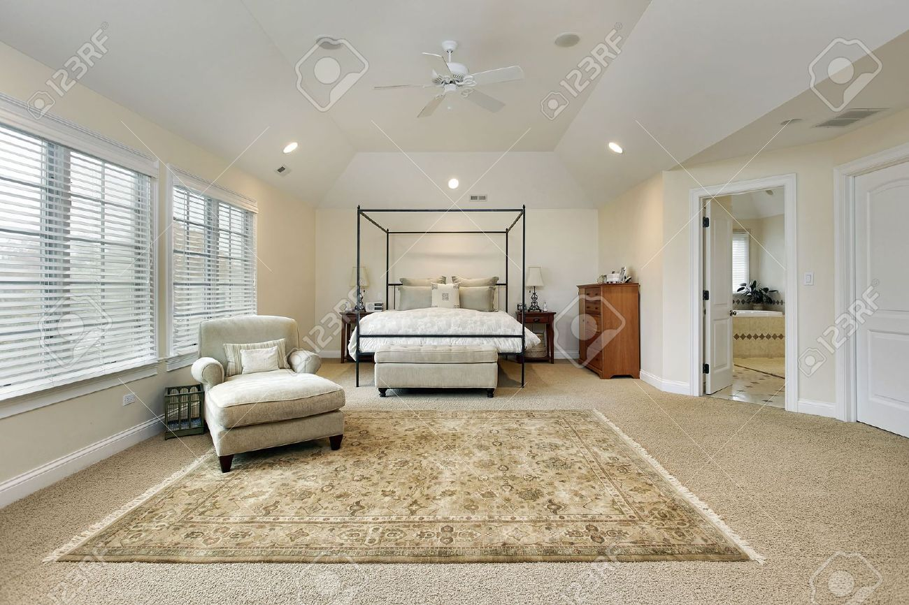 Master Bedroom Tray Ceiling master bedroom in luxury home with tray ceiling stock photo