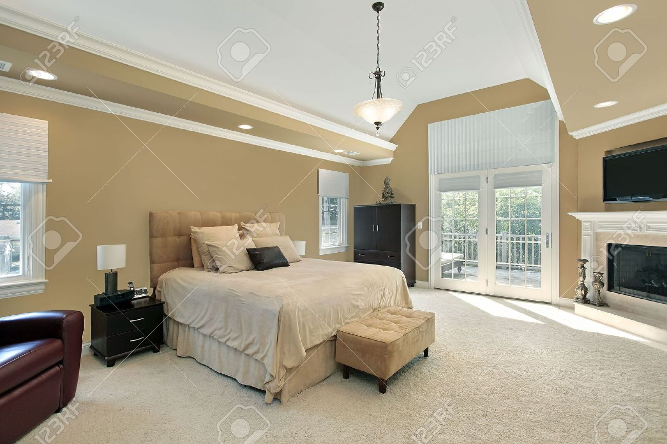 Marvelous Master Bedroom In Luxury Home With Fireplace Stock Photo 6738997