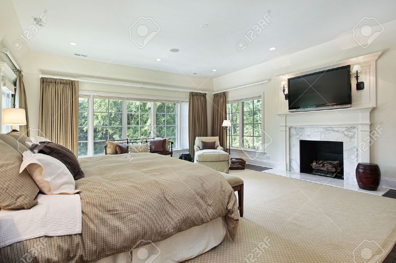master bedroom in luxury home with marble fireplace stock photo 6738909