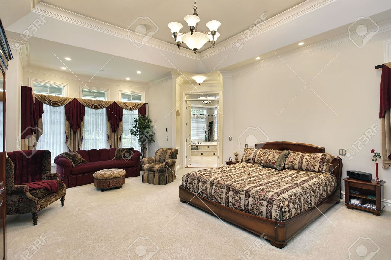 Luxury Homes Master Bedroom master bedroom in luxury home with view into bathroom stock photo