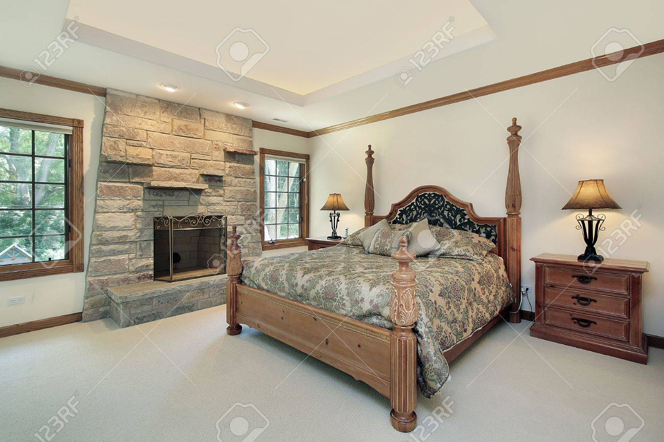 Bedroom stone fireplace - Master Bedroom In Luxury Home With Stone Fireplace Stock Photo 6739302