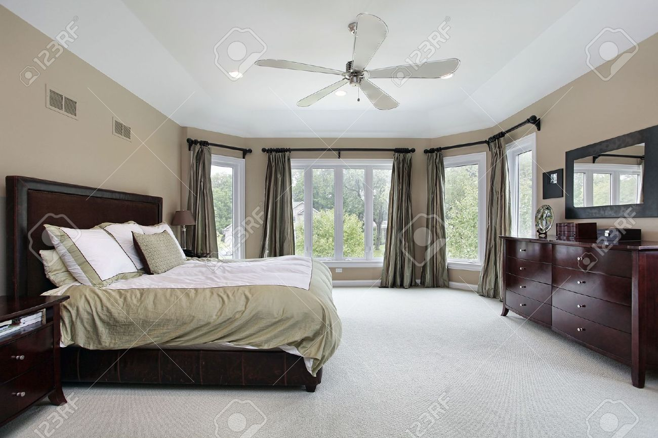 master bedroom in luxury home with wall of windows stock photo 6739125