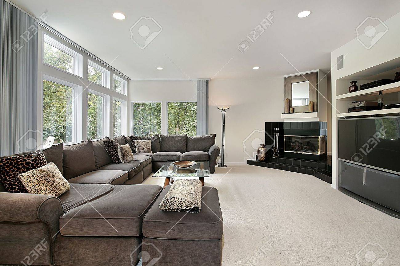 Family Room In Luxury Home With Black Fireplace Stock Photo