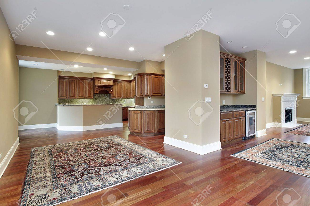 family room in new construction home with cherry wood floors stock
