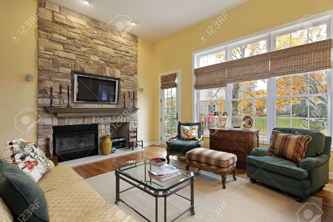 Family Room In Luxury Home With Stone Fireplace Stock Photo ...