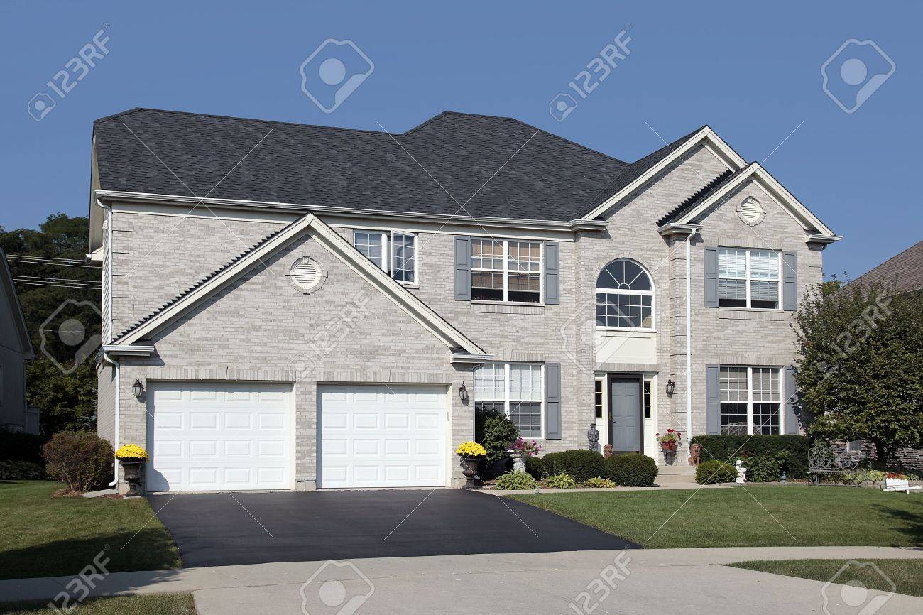 Light brick home in suburbs with double arched garage Stock Photo - 6739059