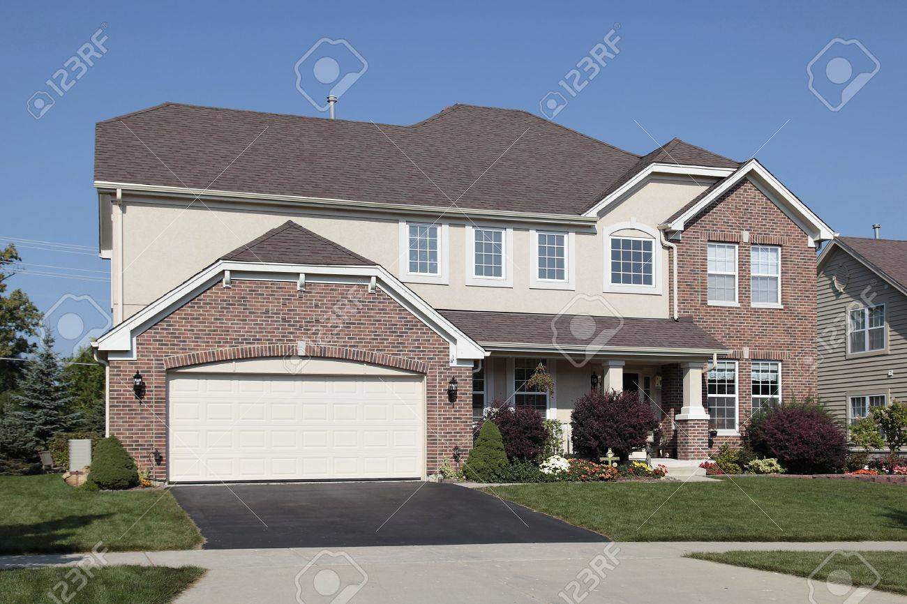Brick home in suburbs with front porch Stock Photo - 6739117