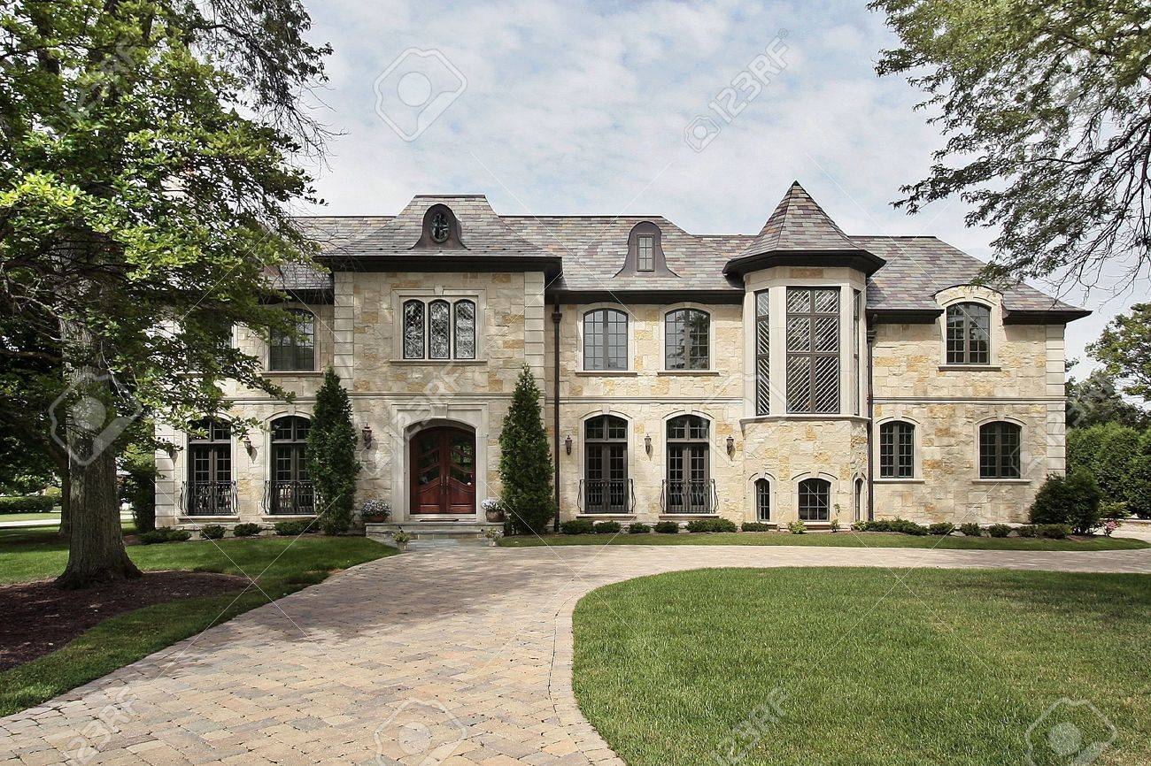 luxury home exterior luxury stone home in suburbs with turret