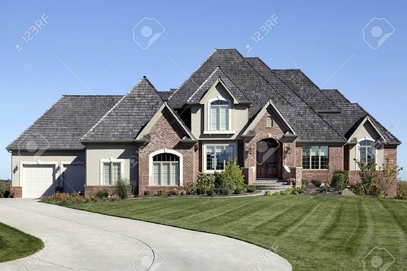 Luxury brick home with cedar shake roof Stock Photo - 6739349
