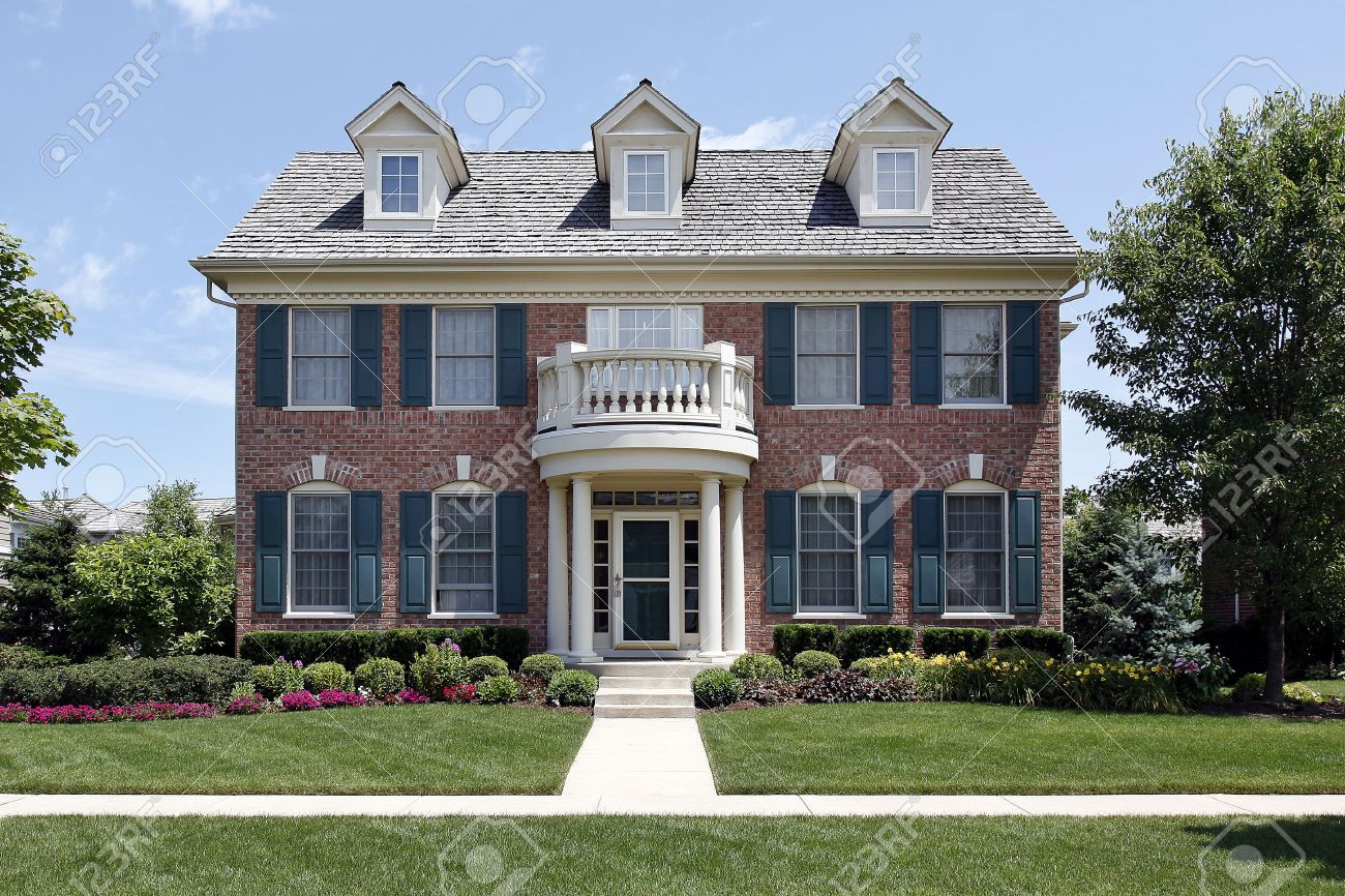 Brick home with front balcony and blue shutters Stock Photo - 6739409