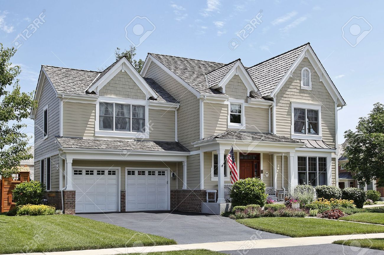 Suburban home with front porch and cedar roof Stock Photo - 6739402