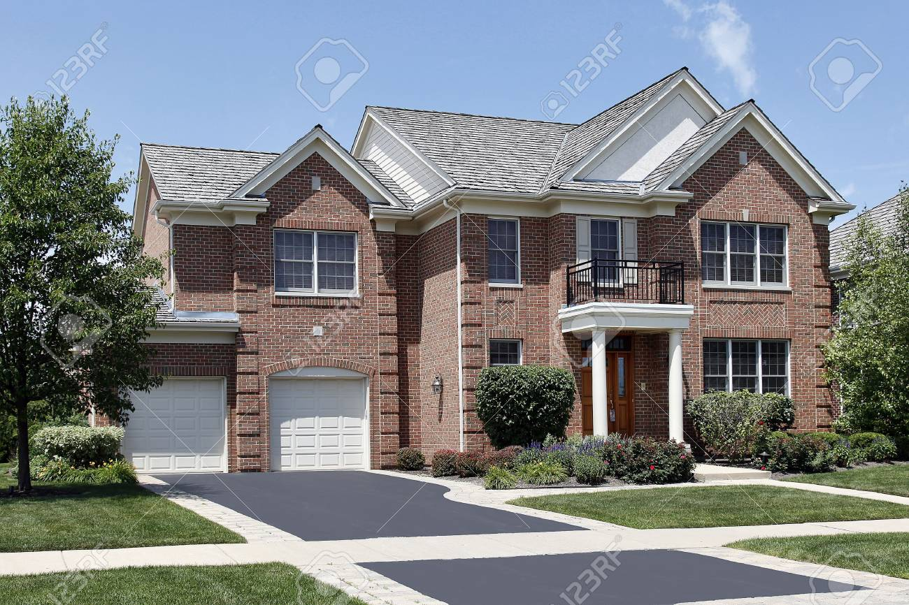 Brick home with columned entry and front balcony Stock Photo - 6739356