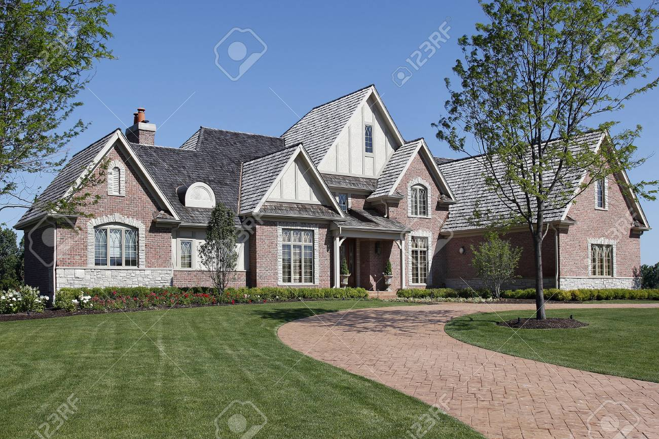 Large brick home with covered entry way Stock Photo - 6739406