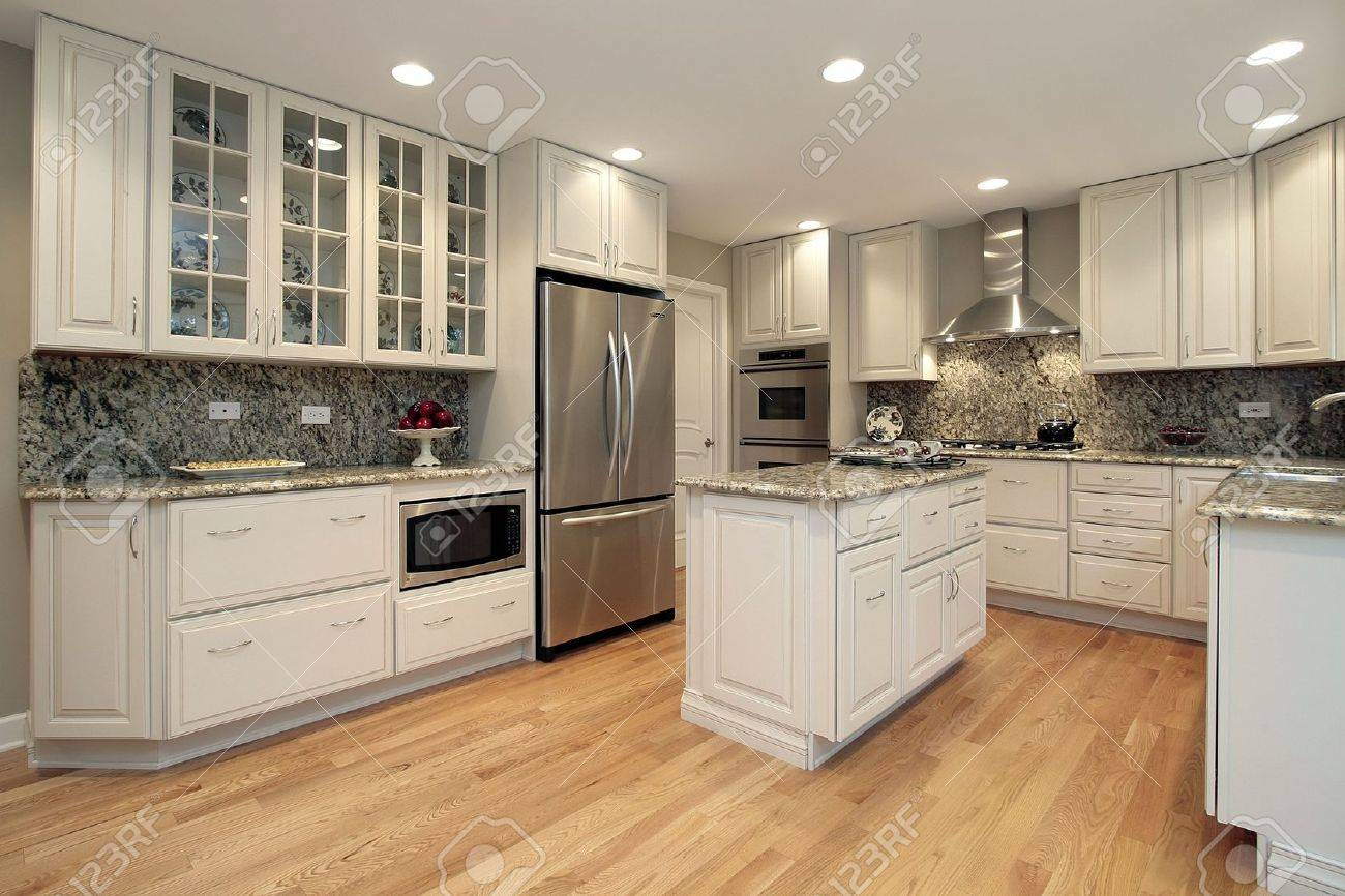Kitchen in suburban home with light colored cabinetry Stock Photo - 6738227