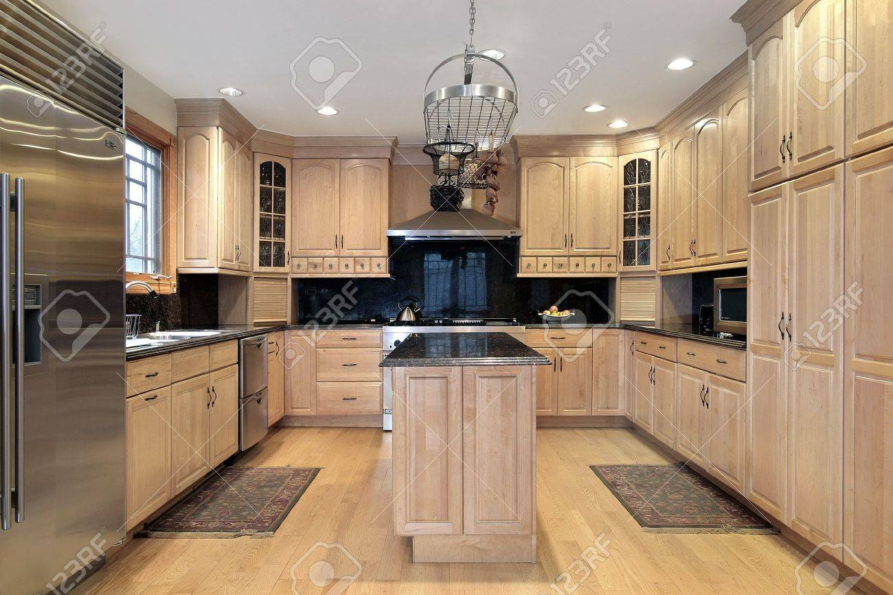 Kitchen in new construction home with oak wood cabinetry Stock Photo - 6738697