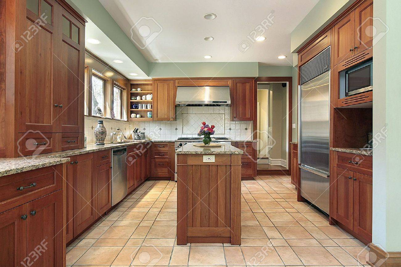 Kitchen in upscale home with wood cabinetry Stock Photo - 6738547