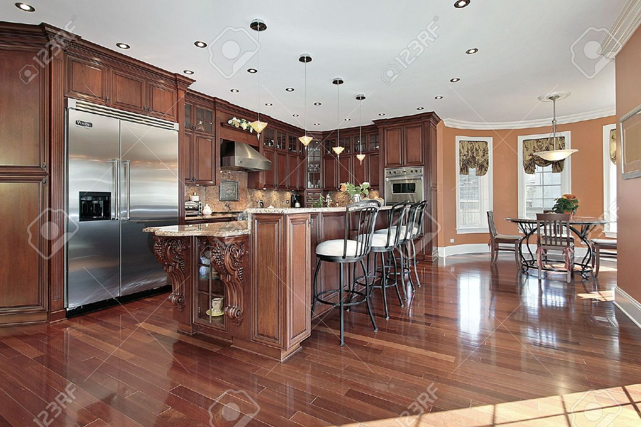 Kitchen in new construction home with cherry wood cabinetry Stock Photo - 6738509