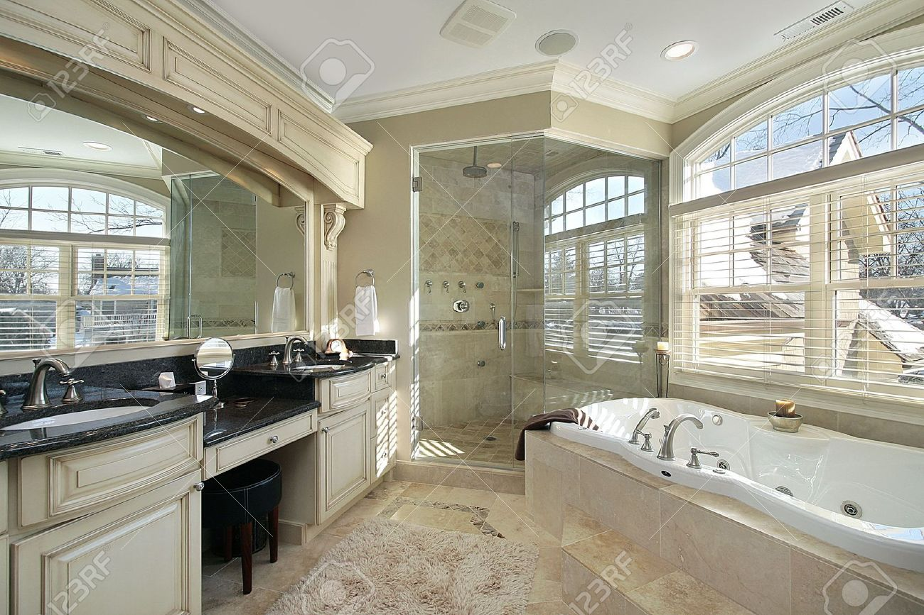 Luxury master bathroom - Master Bath In Luxury Home With Glass Shower Stock Photo 6738823