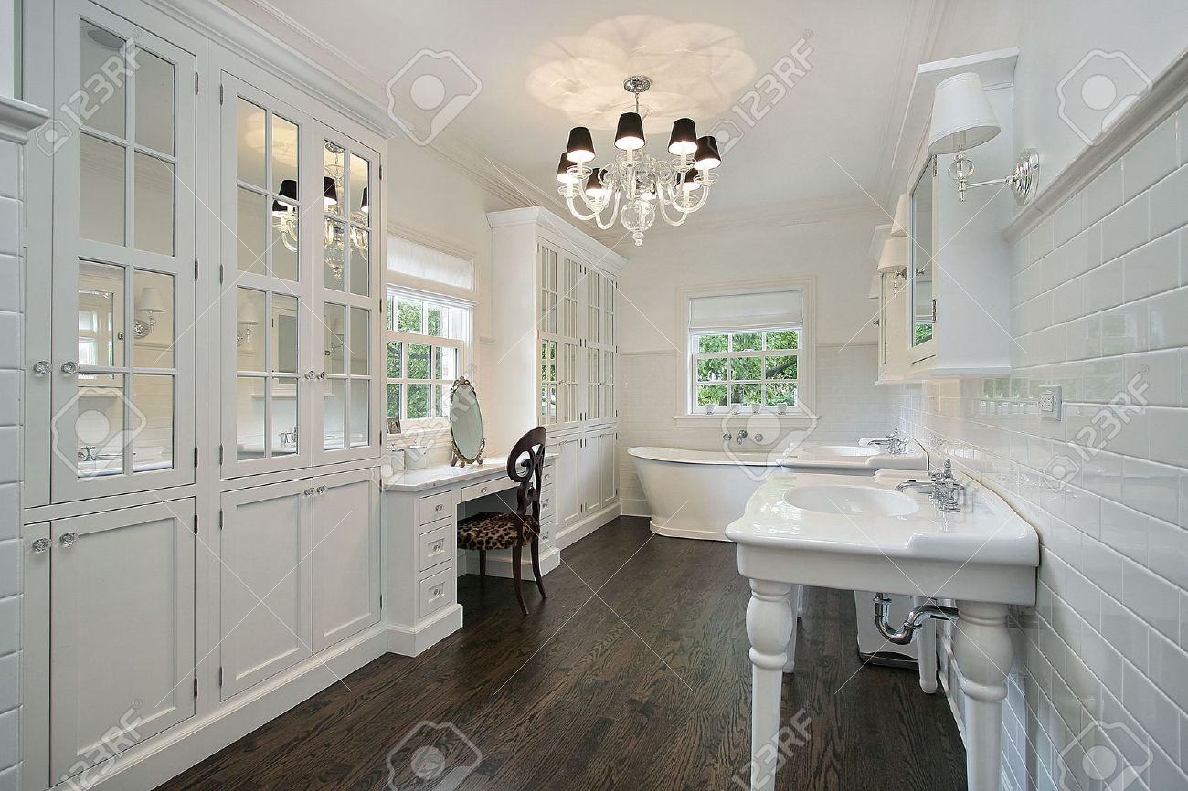white master bath with dark wood floors stock photo picture and