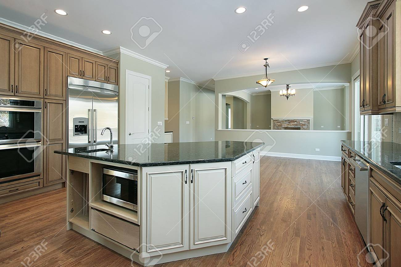 Kitchen in new construction home with family room view Stock Photo - 6739740