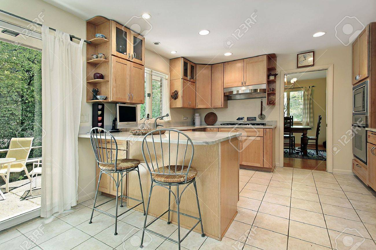Kitchen with breakfast bar and patio view