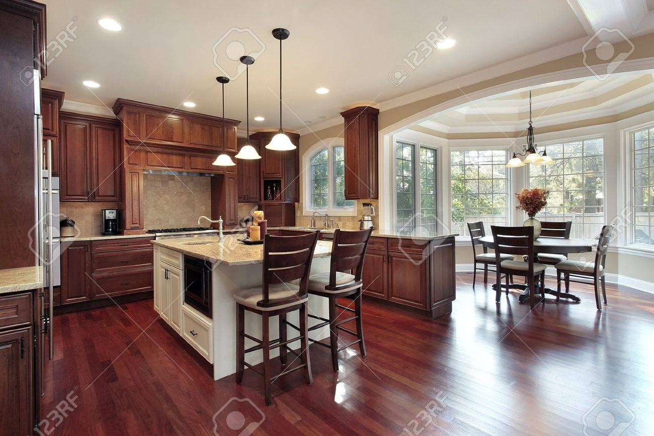 Kitchen Eating Area Kitchen With Eating Area And Cherry Wood Flooring Stock Photo