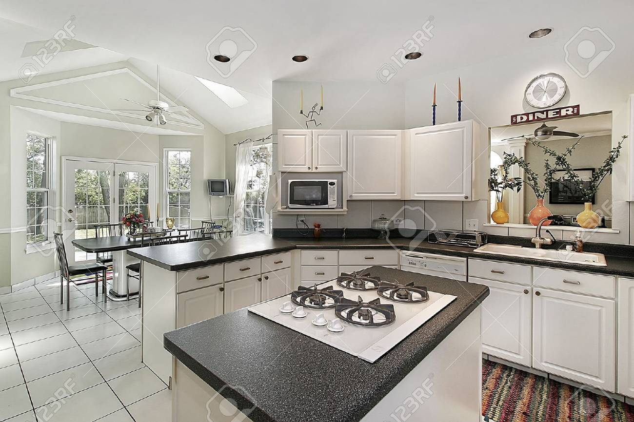 Kitchen in suburban home with white cabinetry Stock Photo - 6739819