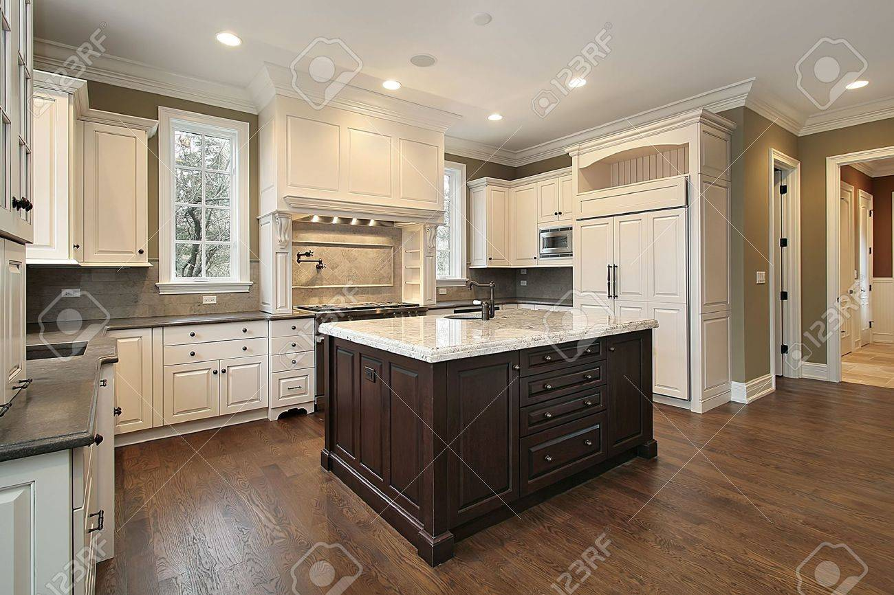 Kitchen In New Construction Home With Wood And Granite Island Stock Photo    6739663