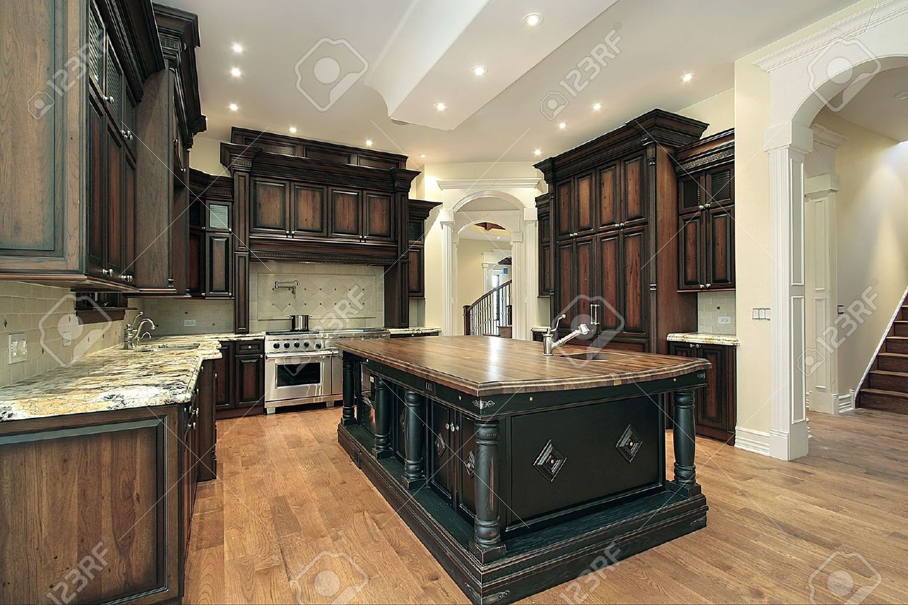 Kitchen in new construction home with dark wood cabinetry Stock Photo - 6739741