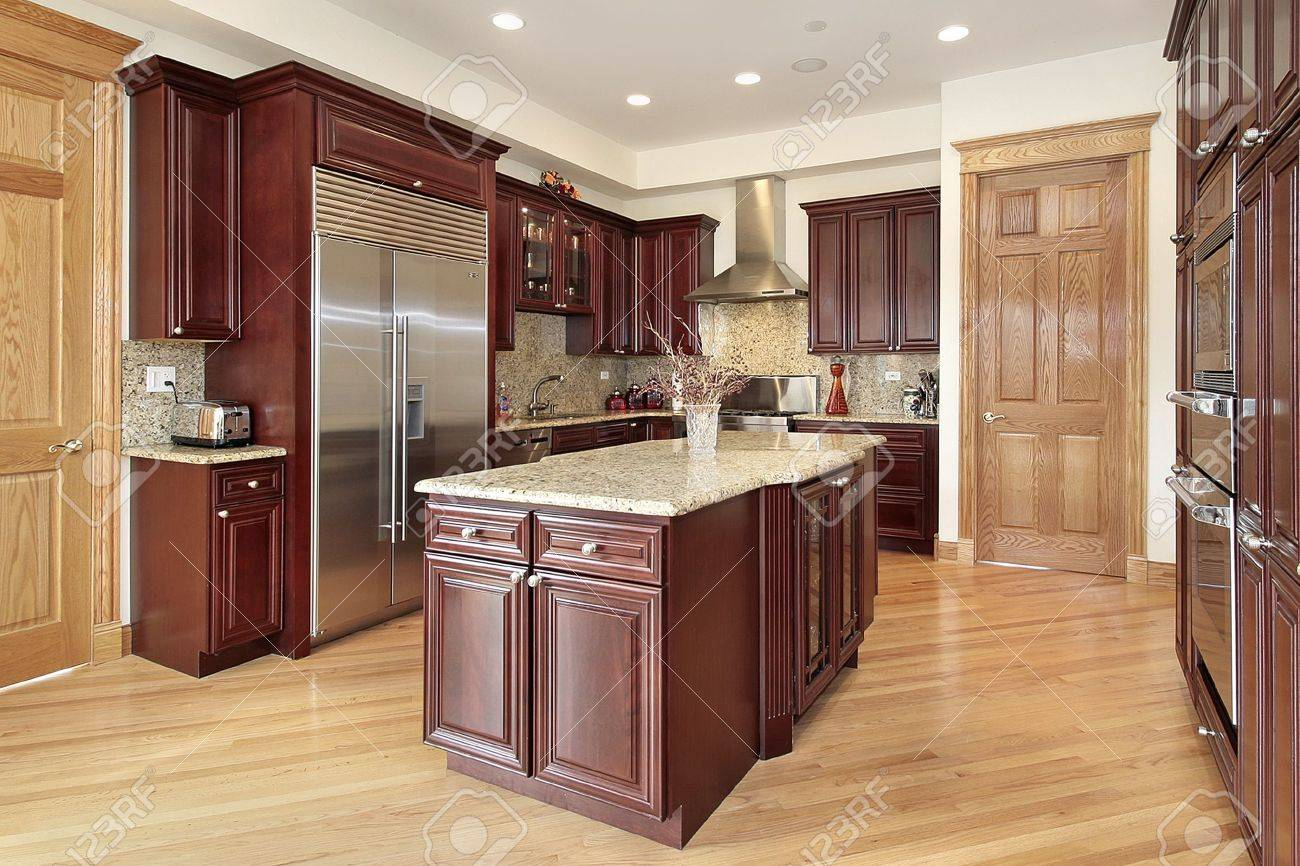 Kitchen In Luxury Home With Cherry Wood Cabinetry Stock Photo Picture And Royalty Free Image Image 6739813