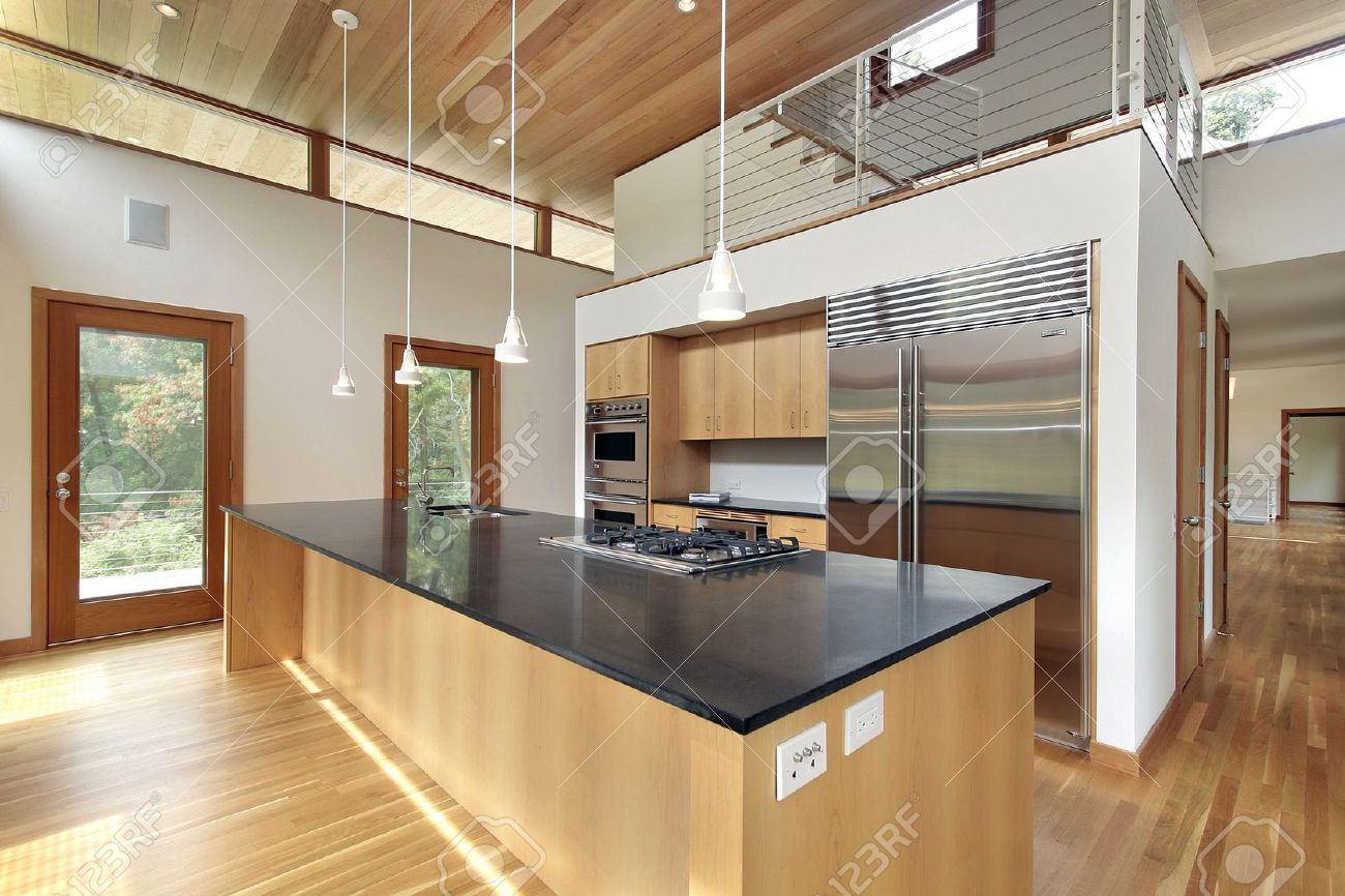 Kitchen Granite Island Kitchen In Ultra Modern Home With Black Granite Island Stock Photo