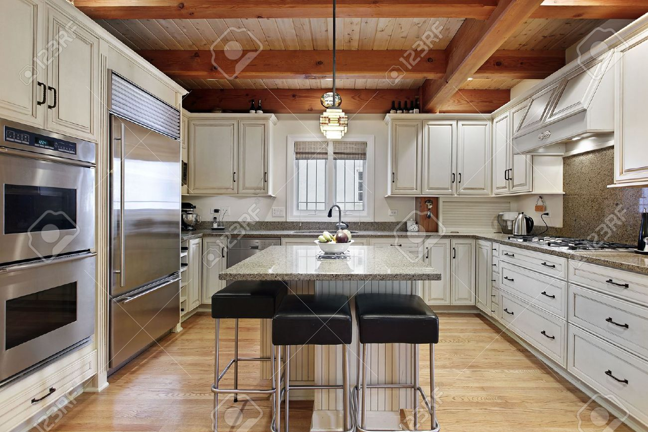 Kitchen in luxury home with wood ceiling beams