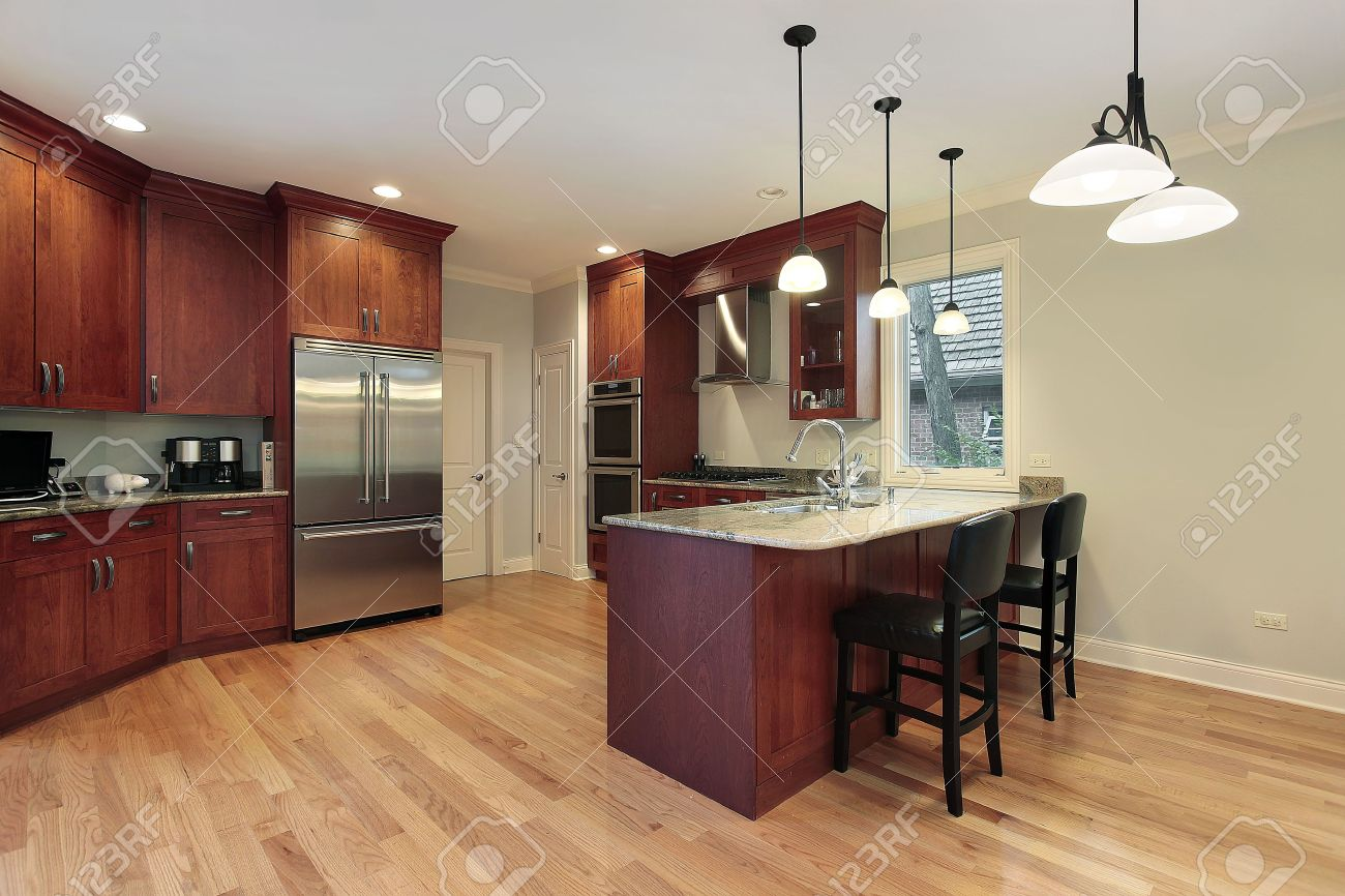 Kitchen designs cherry wood cabinets - Kitchen In Luxury Home With Cherry Wood Cabinetry Stock Photo Kitchen Island