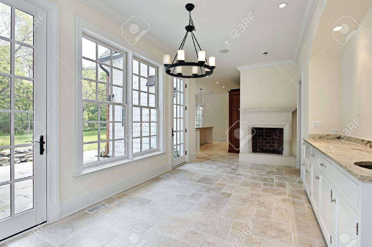 Eating area of new construction home with fireplace Stock Photo - 6739853