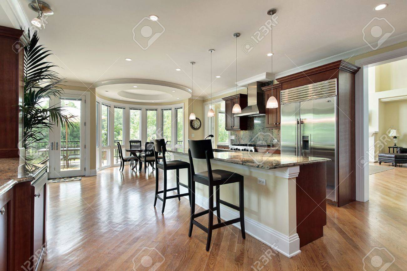 Kitchen Island Eating Area kitchen in luxury home with curved eating area stock photo