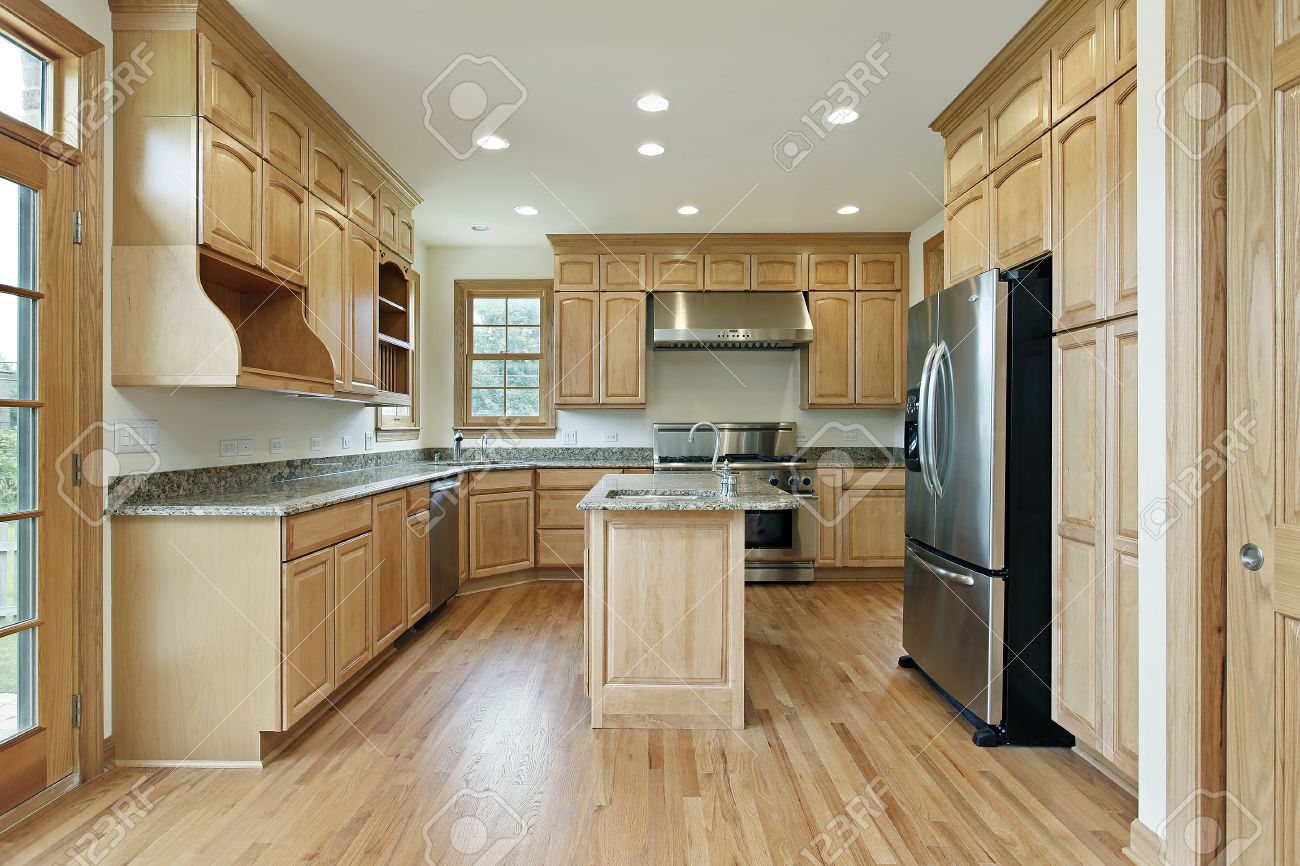 Kitchen in new construction home with oak wood cabinetry Stock Photo - 6739880