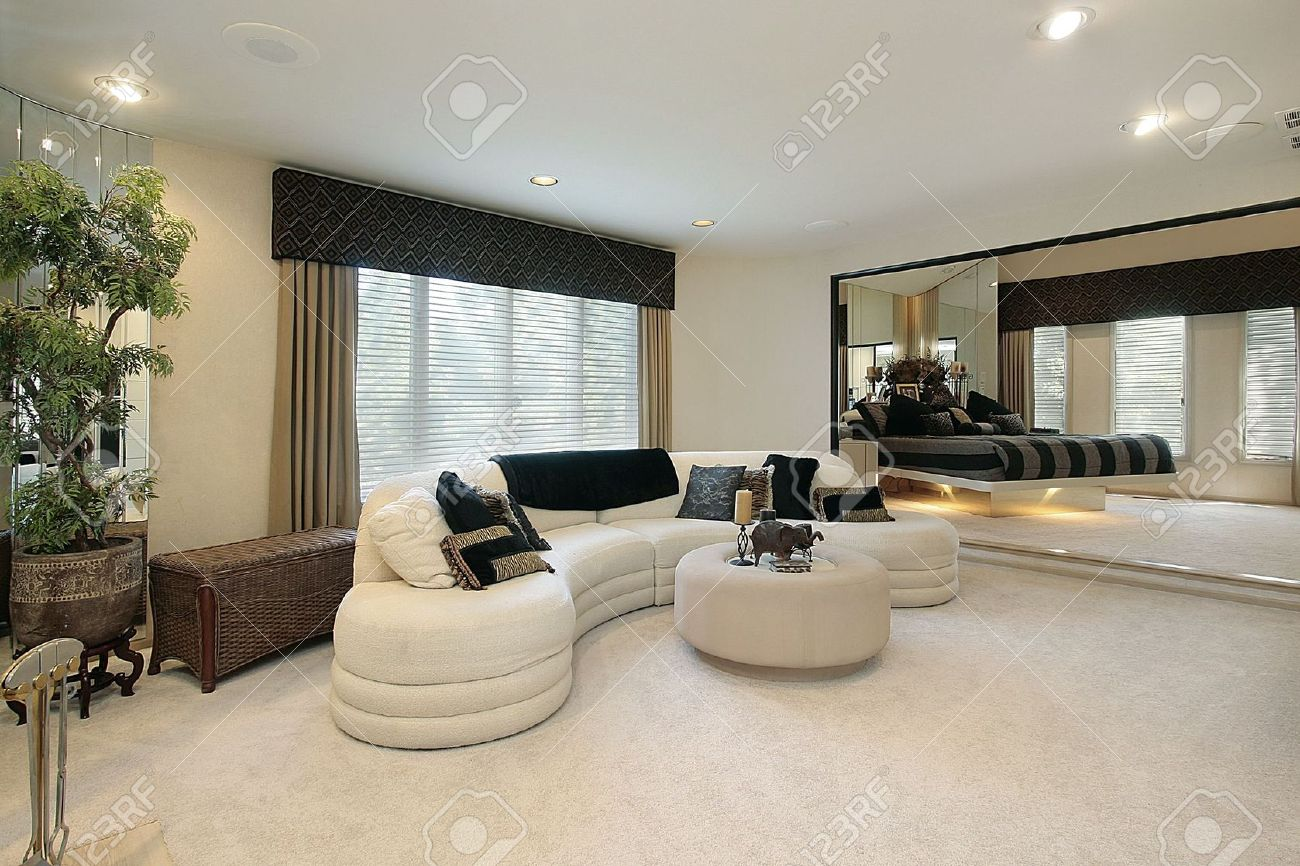 Living room in luxury home with mirrored walls stock photo living room in luxury home with mirrored walls stock photo 6739927 amipublicfo Choice Image