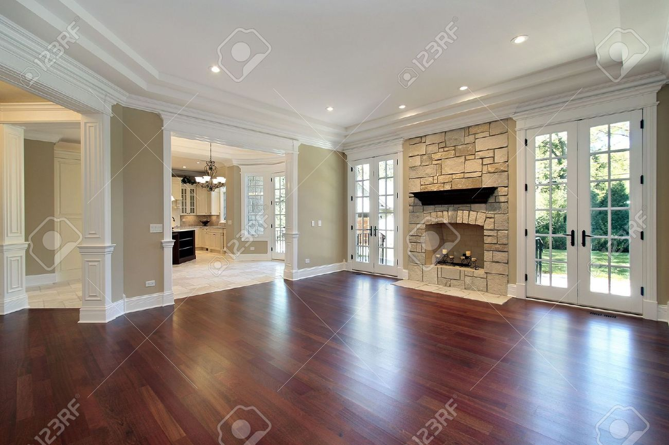 Living Room In New Construction Home With Stone Fireplace Stock ...