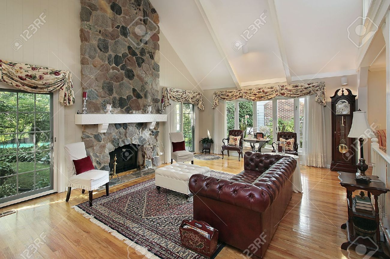 Living Room In Home With Stone Fireplace Stock Photo Picture And