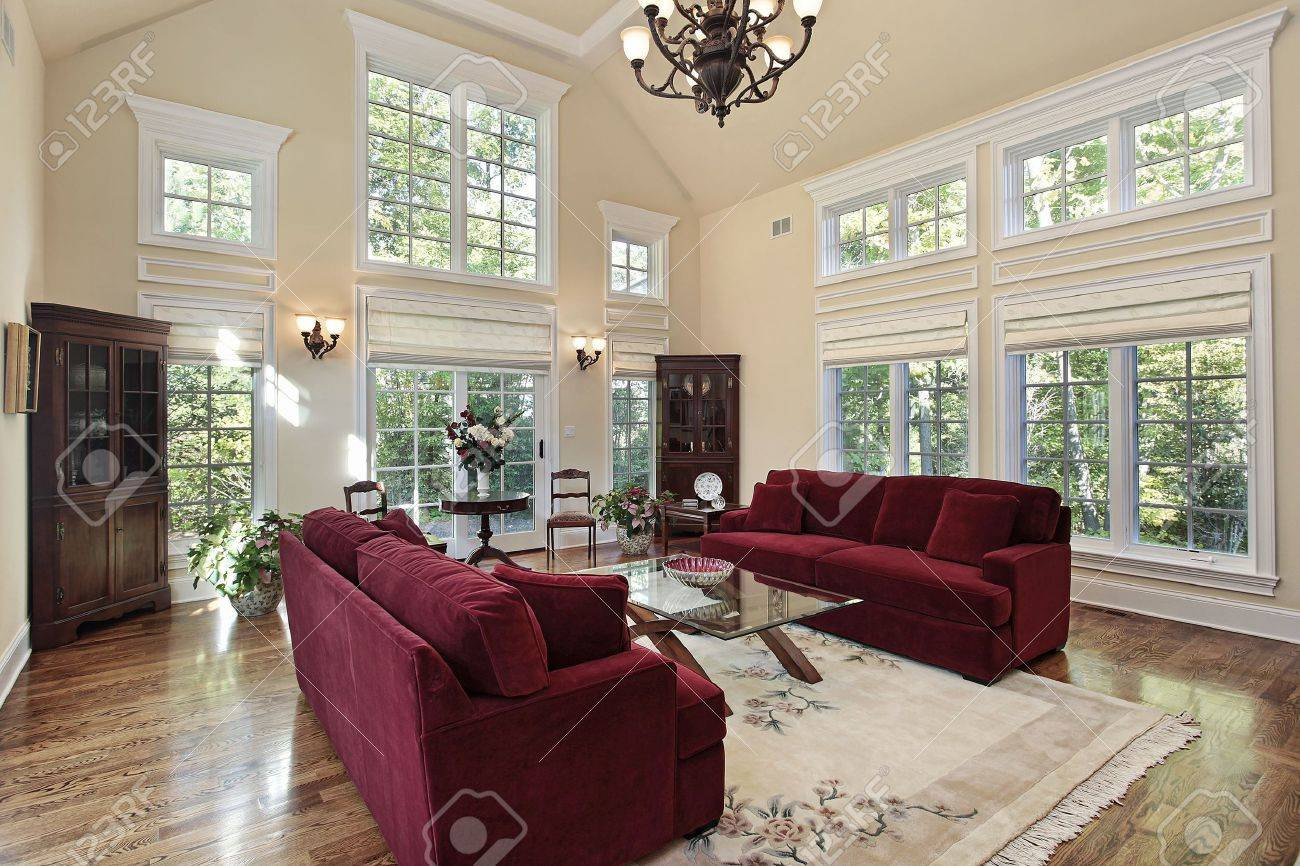 Two Story Living Room Decorating Living Room In Luxury Home With Two Story Windows Stock Photo