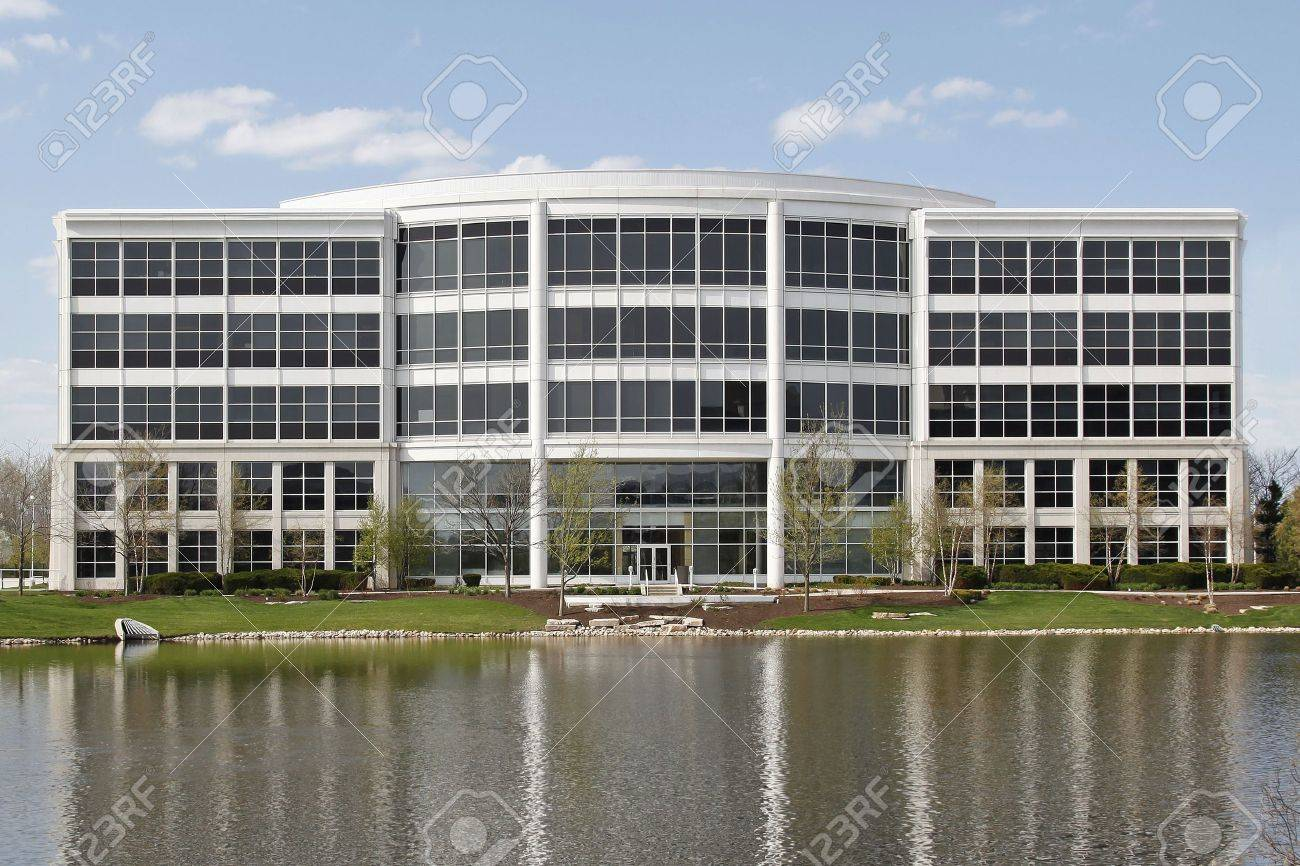 Office building in suburbs with lake in back Stock Photo - 6740592