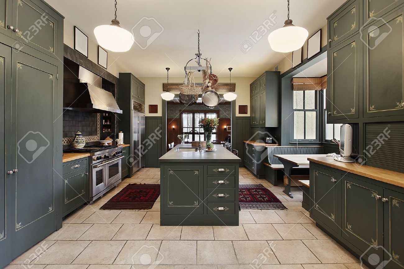 Large kitchen in luxury home with green cabinetry Stock Photo - 7773990