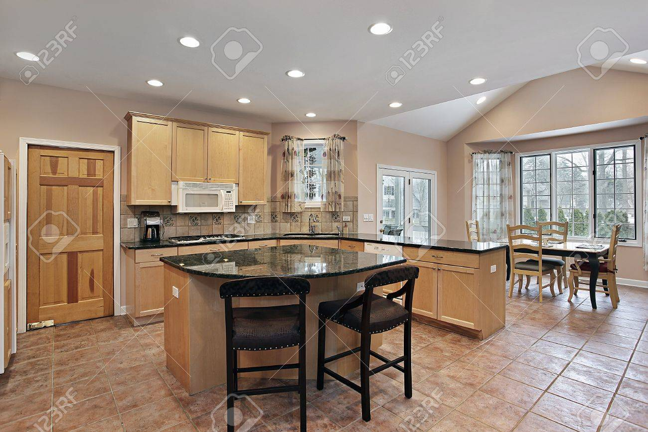 luxury kitchen with eating area and center island stock photo
