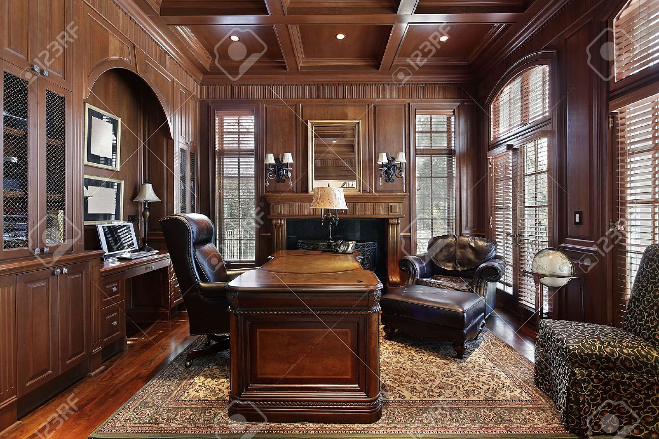 Library in luxury home with large desk stock photo picture and