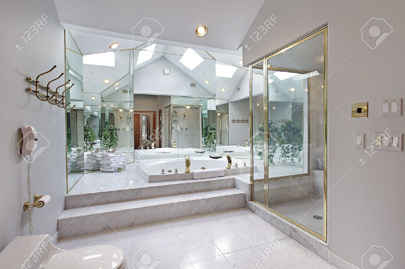 Master bath in luxury home with mirrored tub area Stock Photo - 7750853